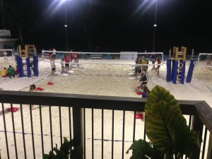Playing cornhole in volleyball courts